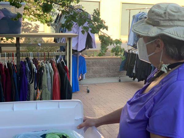Sorting clothes for Celebration Closet